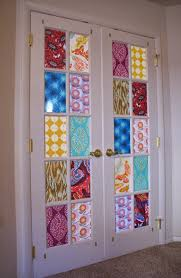 cover french door windows with fabric for a stained glass effect
