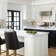 kitchen with black island and white cabinets black and white kitchen houzz