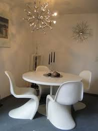 saarinen table eames stools and panton chair yes please home