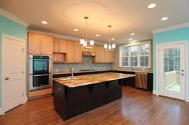 maple cabinets with black island kitchen stanton homes