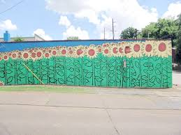 best spots in nashville to take a picture helene in between import flowers nashville mural