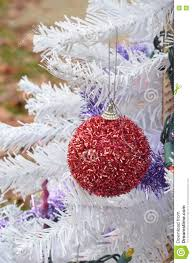 fuzzy red glitter christmas ornament hanging white christmas tree