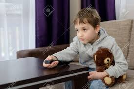 where to buy free hug sofa 7 year old boy child sitting on the sofa and watching tv hugs