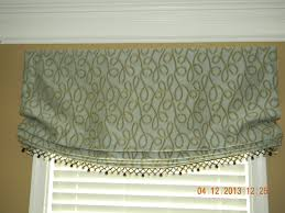 this relaxed roman valance adorns a library in the virginia run