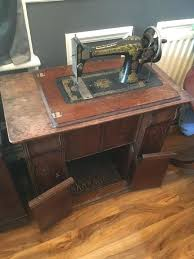 used sewing machine cabinet used sewing machine cabinet sewing table that i found at a thrift