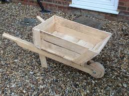 Wooden Wheelbarrow Planter by How To Build A Planter Box Wheelbarrow 14 Steps With Pictures