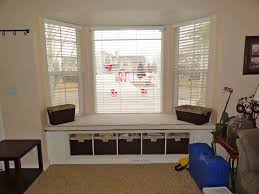 interior spacious dining room design with white bay window blind