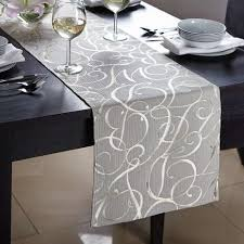 what is a table runner elegant gold script table runner dunelm