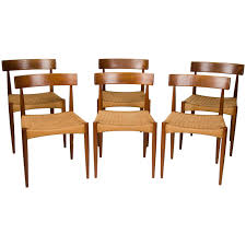 a set of six danish dining chairs manufactured in teak with woven