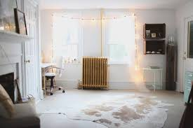 hanging christmas lights around windows 13 ways to decorate with string lights right now window lights