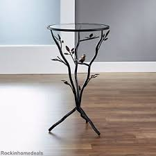 end table glass top metal bronze base room nature bird tree branch