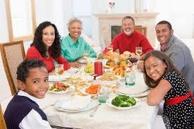 happy family enjoying thanksgiving dinner stock photo colourbox