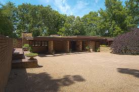 frank lloyd wright inspired home with lush landscaping partying at this midtown kansas city frank lloyd wright home is like