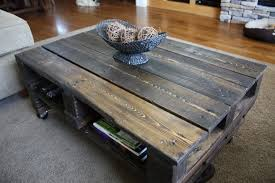 Wood Coffee Table Plans Free by White Painted Pallet Wood Coffee Table On Wheel Plus Bookshelves
