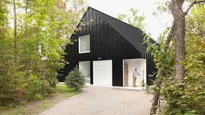 black beachfront cabin in canada contains expansive white interior