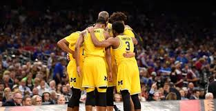 win it all cast michigan basketball is out the mud together and ready to shock