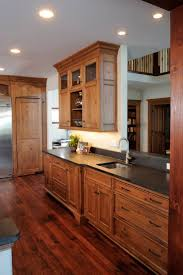 cherry wood pantry cabinet with dark kitchen cabinets wallpaper