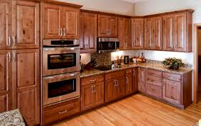 is it better to refinish or replace kitchen cabinets refacing and refinishing is faster and less expensive than