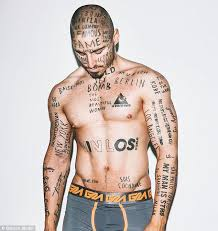 collection of 25 and wording tattoos on stomach
