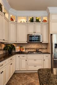 what color countertops with brown cabinets white kitchen cabinets with brown granite page 1 line