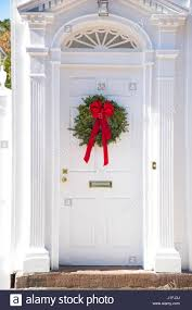 door on a traditional home decorated with a christmas wreath in