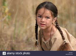 free mative american braids for hair photos a green eyed young native american indian boy portrait stock photo