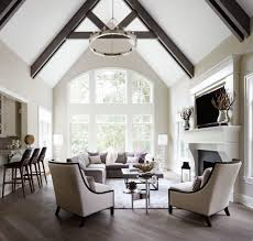vaulted ceiling beams living room transitional with white window