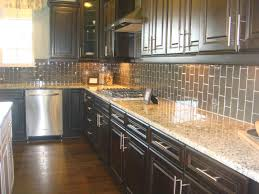 dark brown wooden kitchen cabinets with grey backsplash and