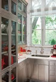 Metal Cabinets Kitchen Transparent Glass Cabinet With A Kitchen Faucet In A Natural