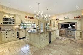 traditional kitchen with large island and stove stock photo