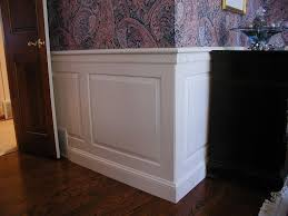 decorating comfortable wood tile floor with white wainscoting panels