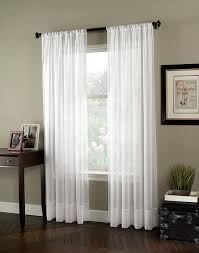 decor white panel curtains with dark wood side table also wall