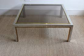 mid century spanish chrome brass and glass coffee table 1970s