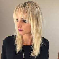 how to cutting bangs in a layered hairstyle get this hairstyle long blonde shaggy layered cut with fringe
