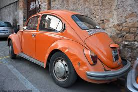 orange volkswagen beetle driven daily volkswagen beetle ran when parked