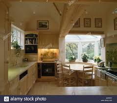oven in lighted alcove in country kitchen with circular wooden