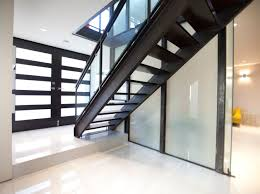 contemporary stair case with wooden steps and glass rails stock