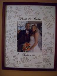 wedding guest book picture frame via bergdesigns on etsy the guestbook photo mat idea