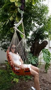 white padded hammock chair with wooden arm rests hammock chairs