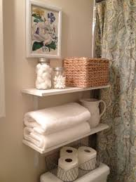 Shelves Over Bed White Tone Floating Shelves With Folded Towel Attached Brown Wall
