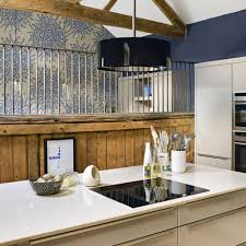 wainscoting kitchen island kitchens pale kitchen with branch patterned wallpaper also