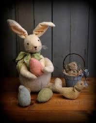 primitive easter eggs primitive easter bunny rabbit doll in a green print easter dress egg