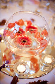 Vases With Flowers And Floating Candles Floating Wedding Flowers For The Dreamiest Reception Mywedding