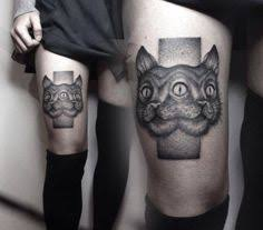 black ink cat with two heads and fish on forearm