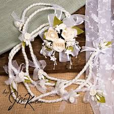 arras para boda stunning white lazo with large centerpiece flowers wedding lasso