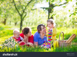 happy family garden family children enjoying picnic spring garden stock photo