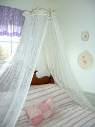 Girls Striped Bedding by Brown Wooden Canopy Beds With White Curtains Plus Striped Bedding