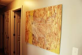 World Map On Wood Planks by Diy Map String Art With An Industrial Vibe