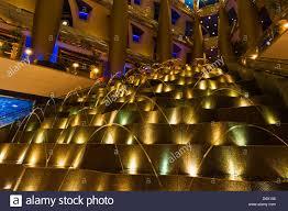 a water fountain in the lobby of the burj al arab hotel dubai