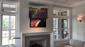 hide your tv with art the media décor eclipse vertical art lift